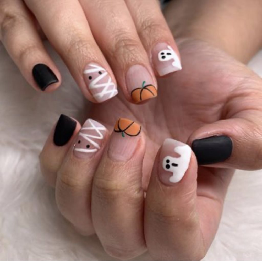 Pumpkin and mummy nail art